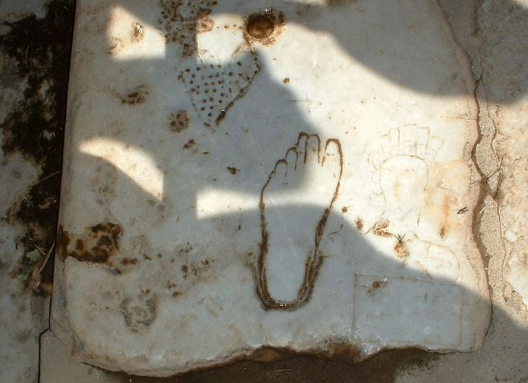 Footprint at Ephesus showing the way to the whore house