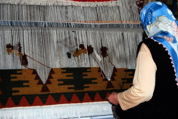 Woman making Turkish carpet